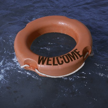 WELCOME photo of Lifebuoy with Welcome text on it, Installation on Mediterranean Sea. By Goran Branko Vidovic for WU+S (wakeupandsleep.org).